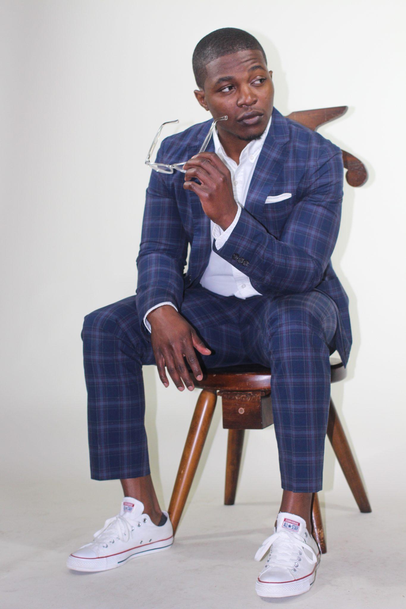 dapper-advisor-black-man-wearing-uniqlo-plaid suit-white-sneakers-clear-glasses-2