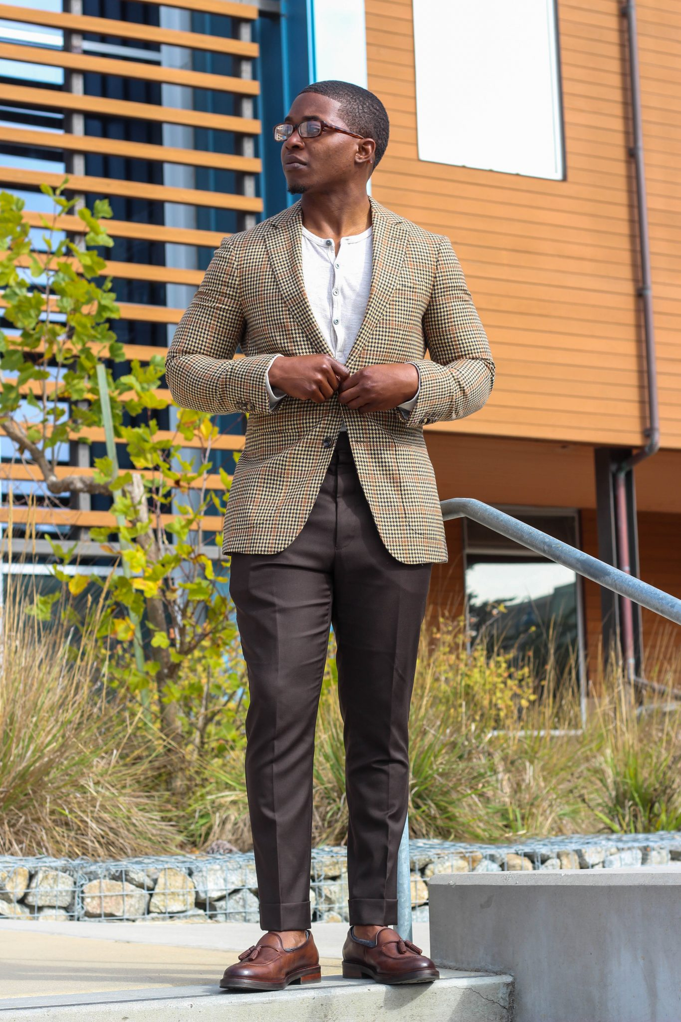 dapper-advisor-casually tailored-black-man-wearing-blazer-henley shirt-brown-trousers-tassel-loafers-3