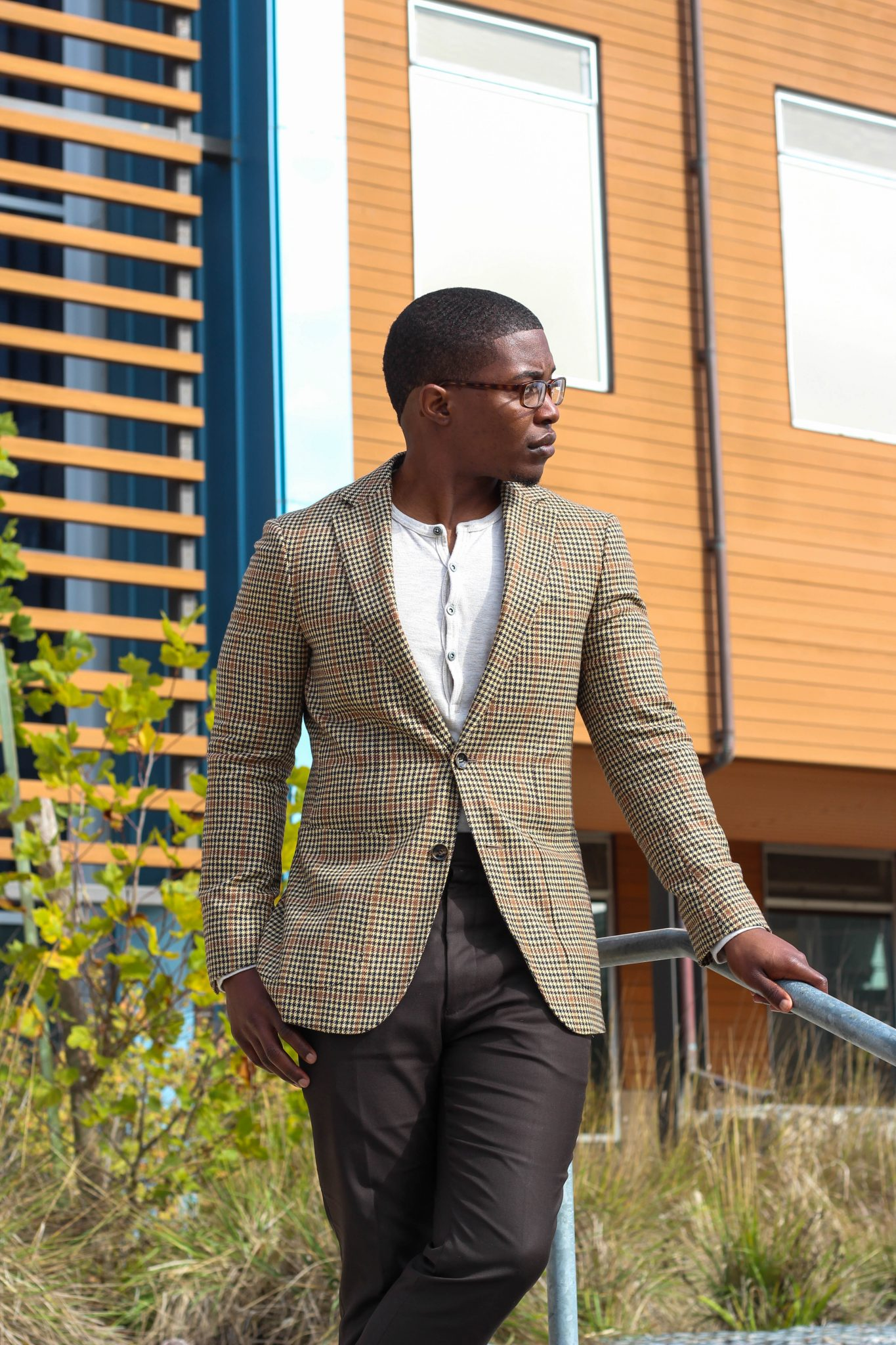 dapper-advisor-casually tailored-black-man-wearing-blazer-henley shirt-brown-trousers-tassel-loafers-4