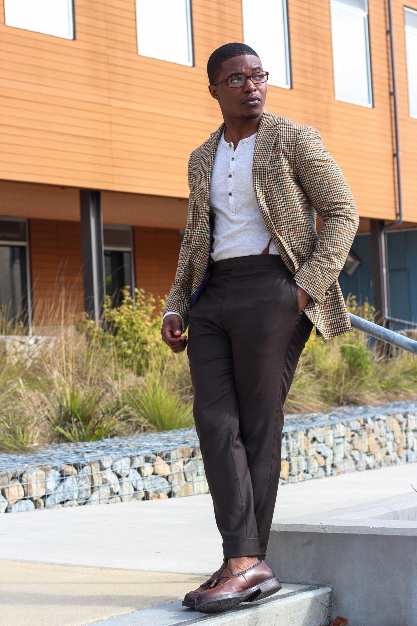 dapper-advisor-casually tailored-black-man-wearing-blazer-henley shirt-brown-trousers-tassel-loafers-2