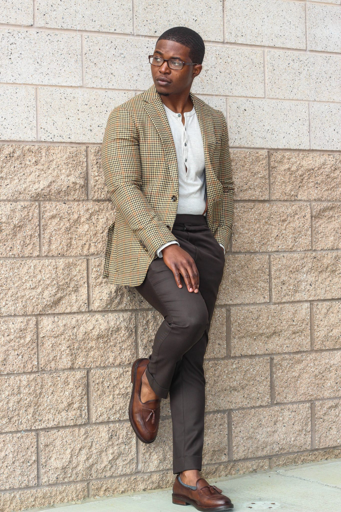 dapper-advisor-casually tailored-black-man-wearing-blazer-henley shirt-brown-trousers-tassel-loafers-1