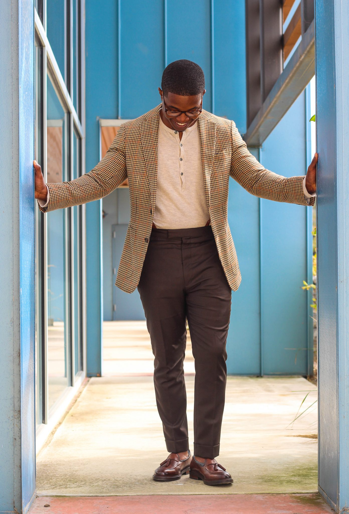 dapper-advisor-casually tailored-black-man-wearing-blazer-henley shirt-brown-trousers-tassel-loafers-5