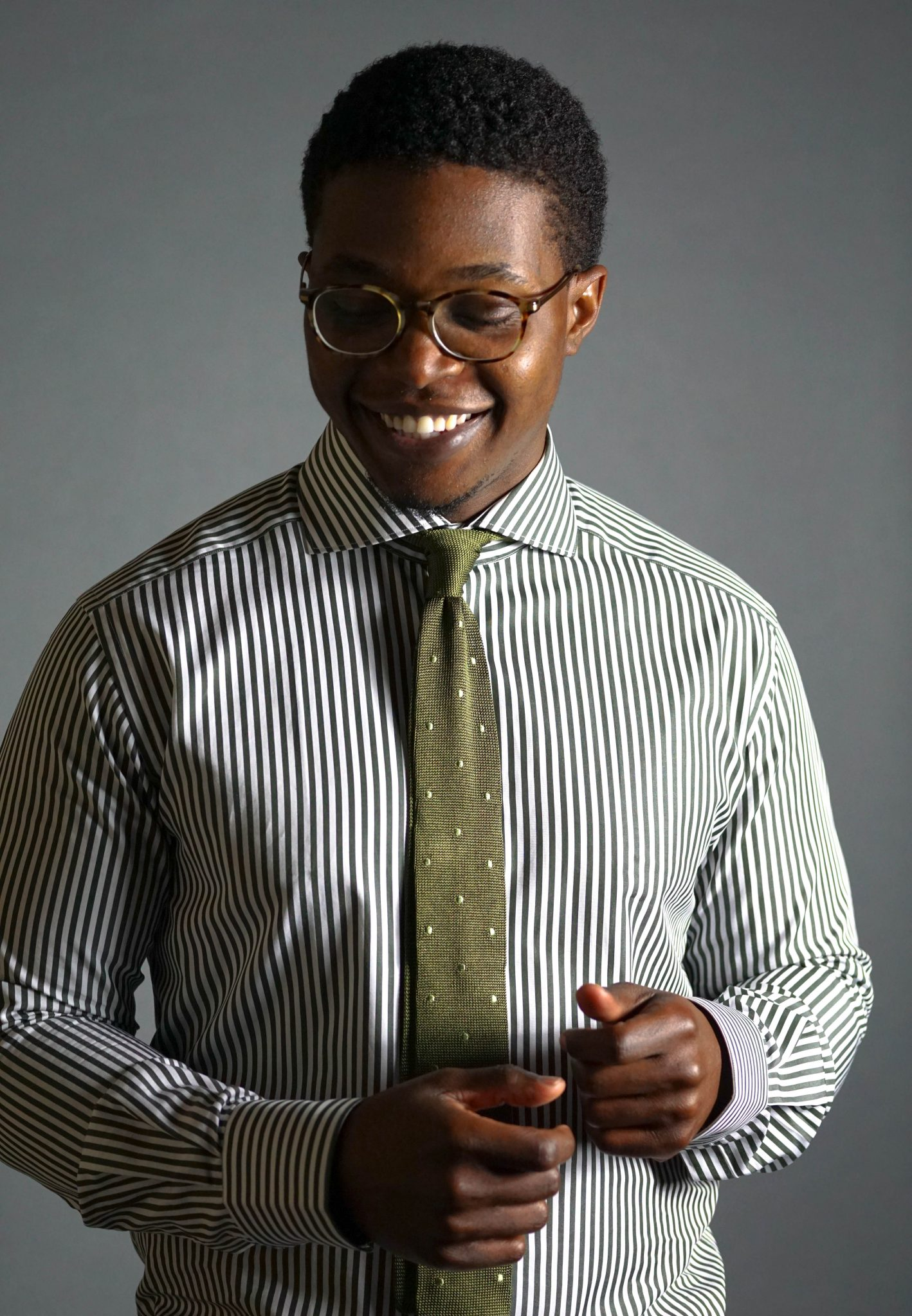 Dapper-Advisor-Akil-McLeod-black-man-african-american-smiling-soxfords-tie-stripe-shirt-knit-tie-smile