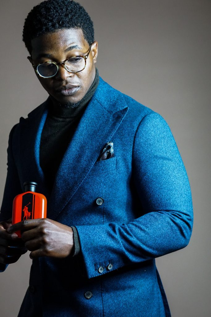 Dapper-advisor-black-man-african-american-holding-intense-red-cologne-fragrance-ralph-lauren-gift-idea-christmas-holiday-2