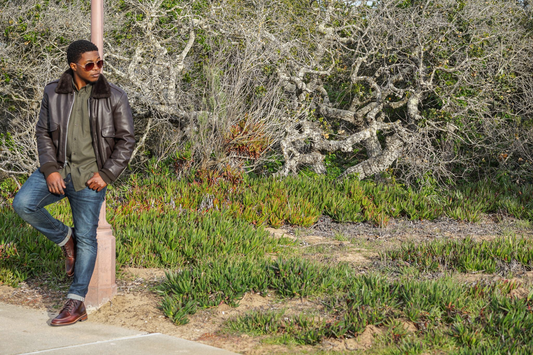 Dapper Advisor Akil McLeod Brown vintage leather bomber jacket green flannel shirt Thursday boot brown diplomats