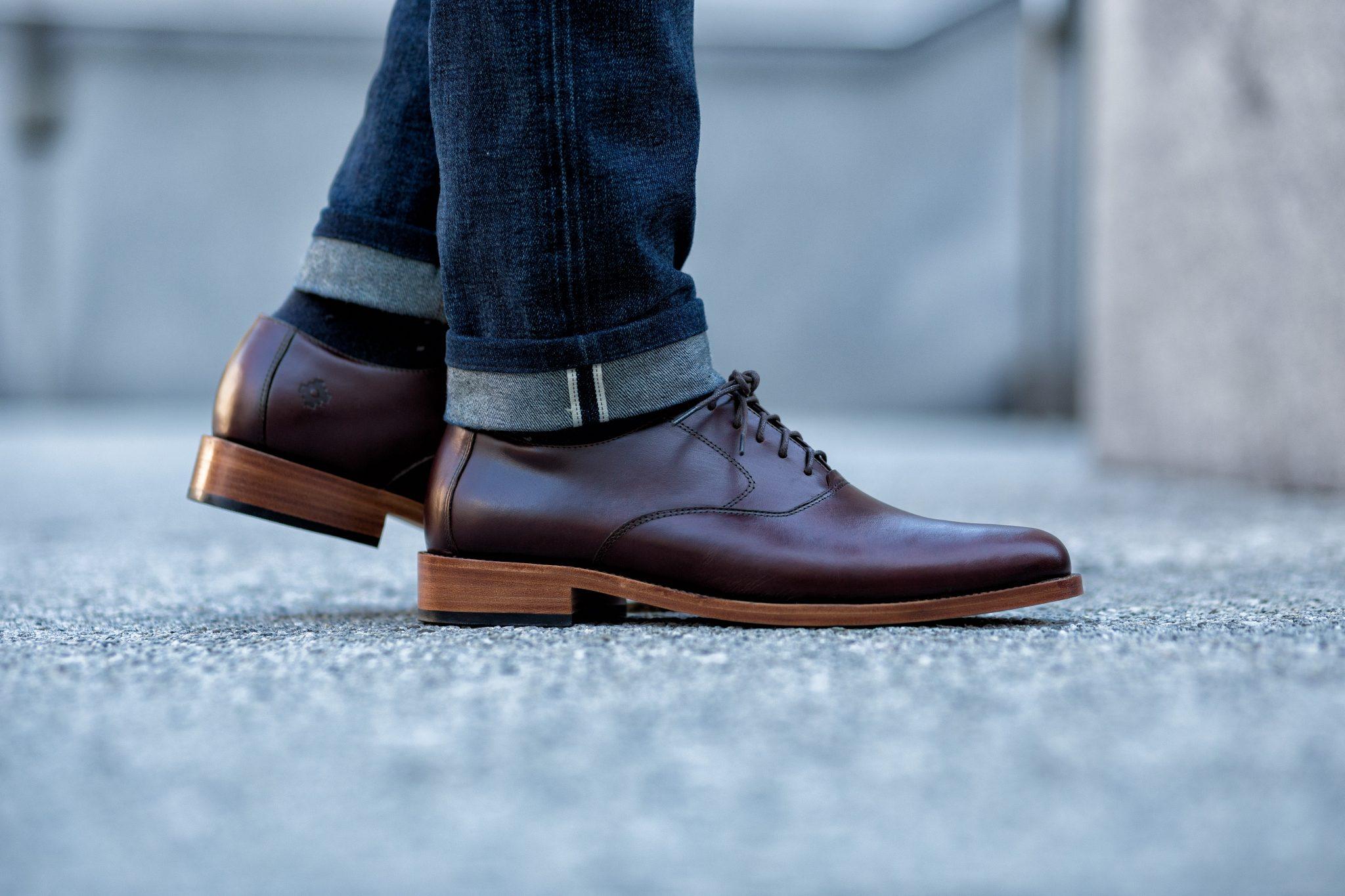 Dapper Advisor black man wearing selvedge denim jeans nisolo burgundy calano