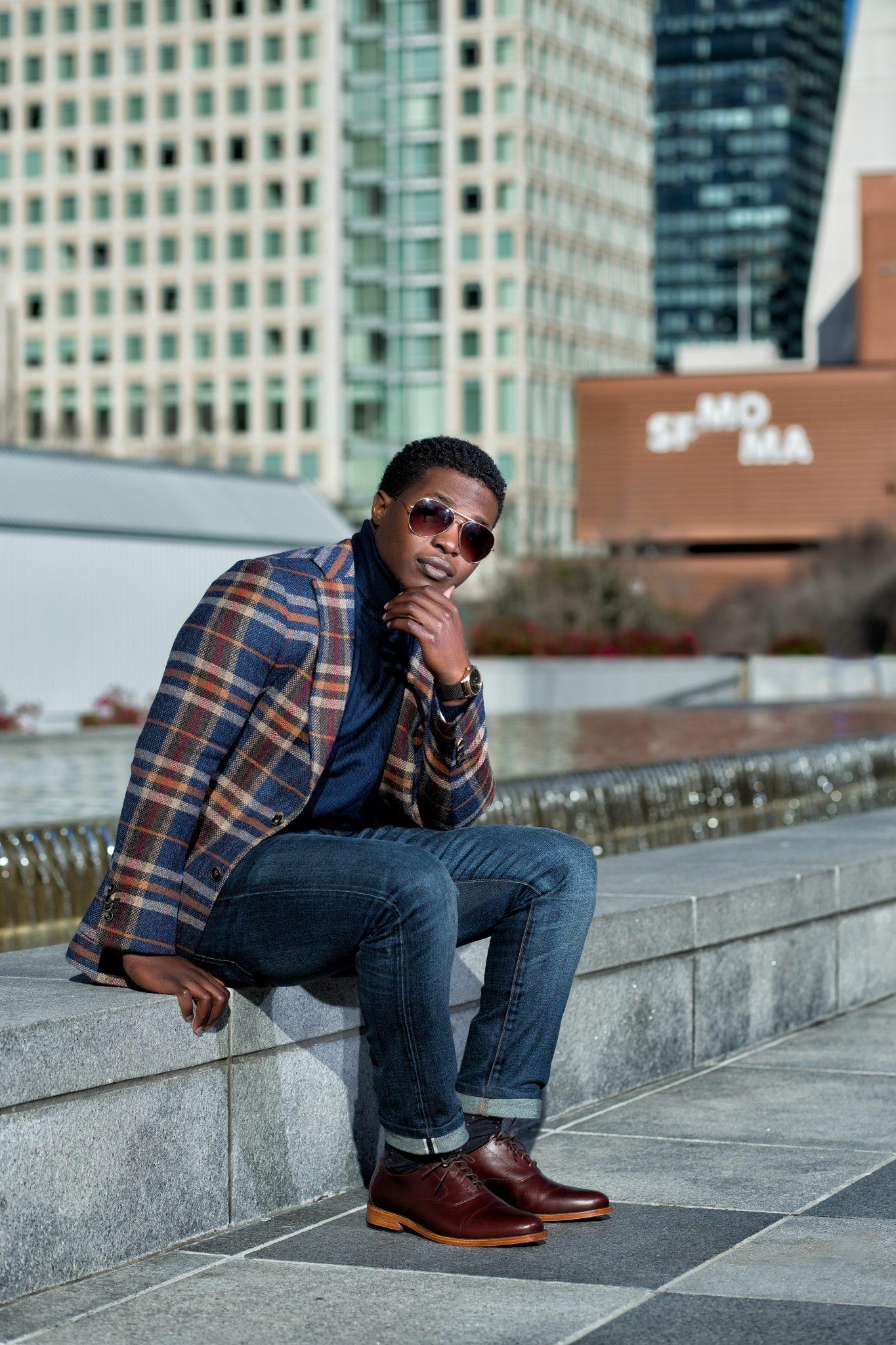 Dapper Advisor black man wearing plaid blazer suit supply navy turtleneck sweater selvedge denim jeans nisolo burgundy calano 5