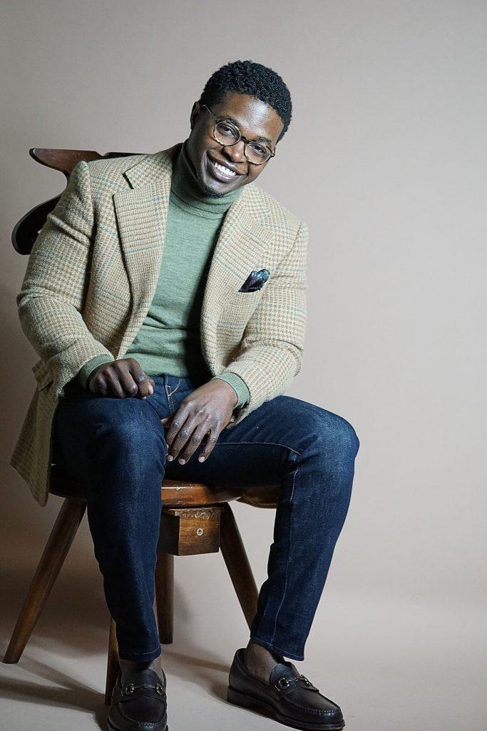 dapper-advisor-black-man-green-turtleneck-jeans-ralph-lauren-alpaca-cashmere-blazer-sebago-brown-heritage-bit-loafers-smiling-christmas