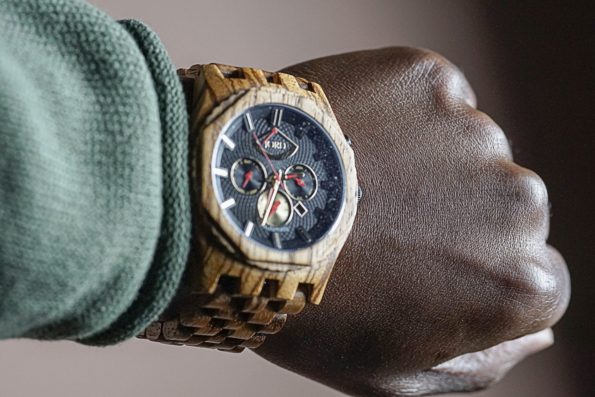 Dapper-Advisor-black-man-green-sweater-jord-wood-watch-christmas-gift-guide-sawyer-series-obsidian-zebrawood-1