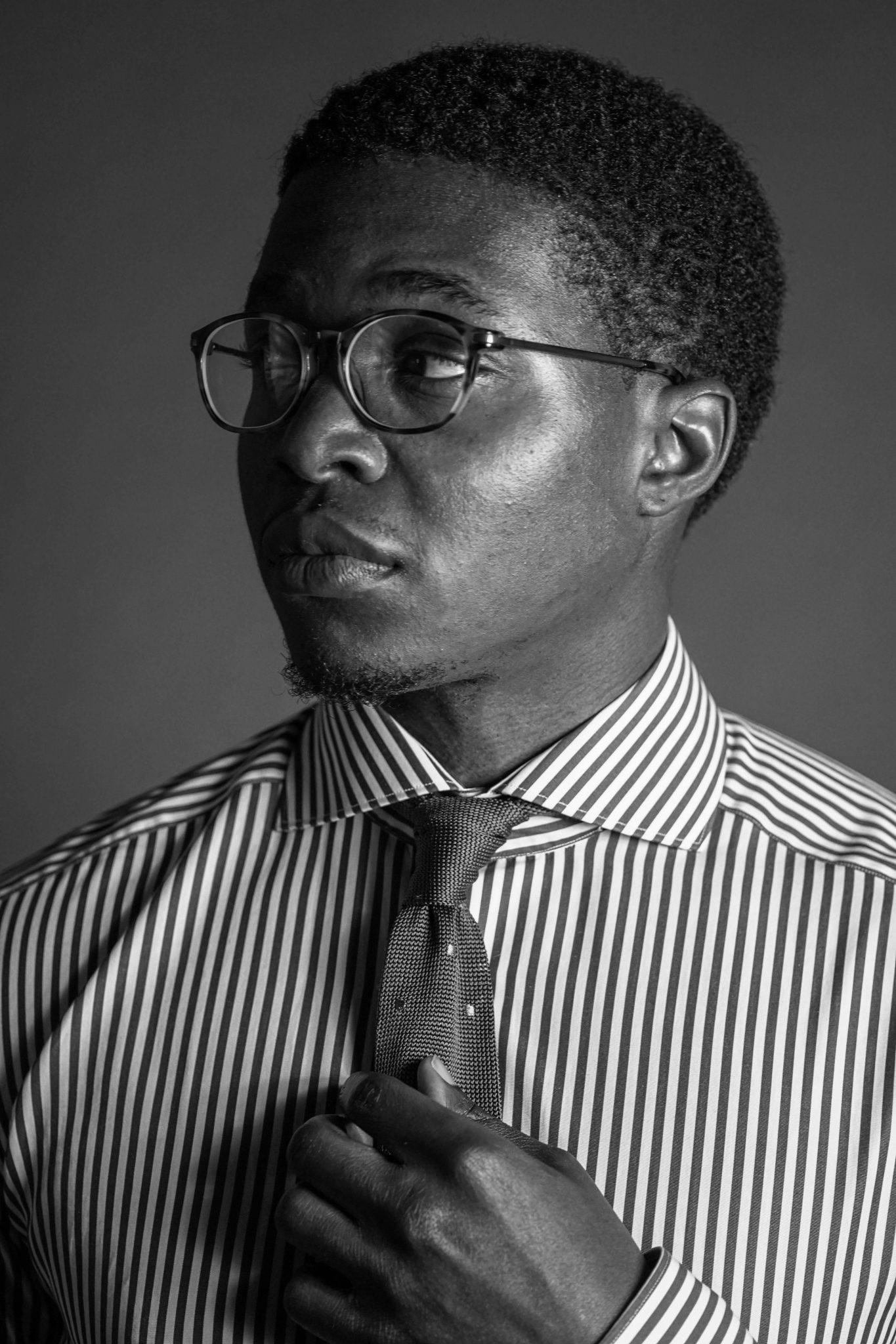Dapper-Advisor-Akil-McLeod-black-man-african-american-portrait-soxfords-tie-stripe-shirt-knit-tie-smile