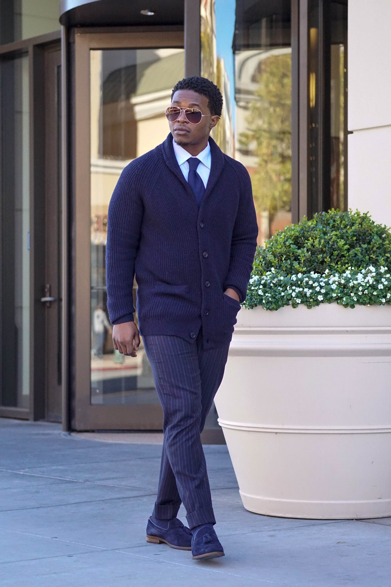 dapper-advisor-business-casual-blue-outfit-mens-navy cardigan-blue-dress-shirt-blue-tie-navy-suede-loafers-grana-black-man-3
