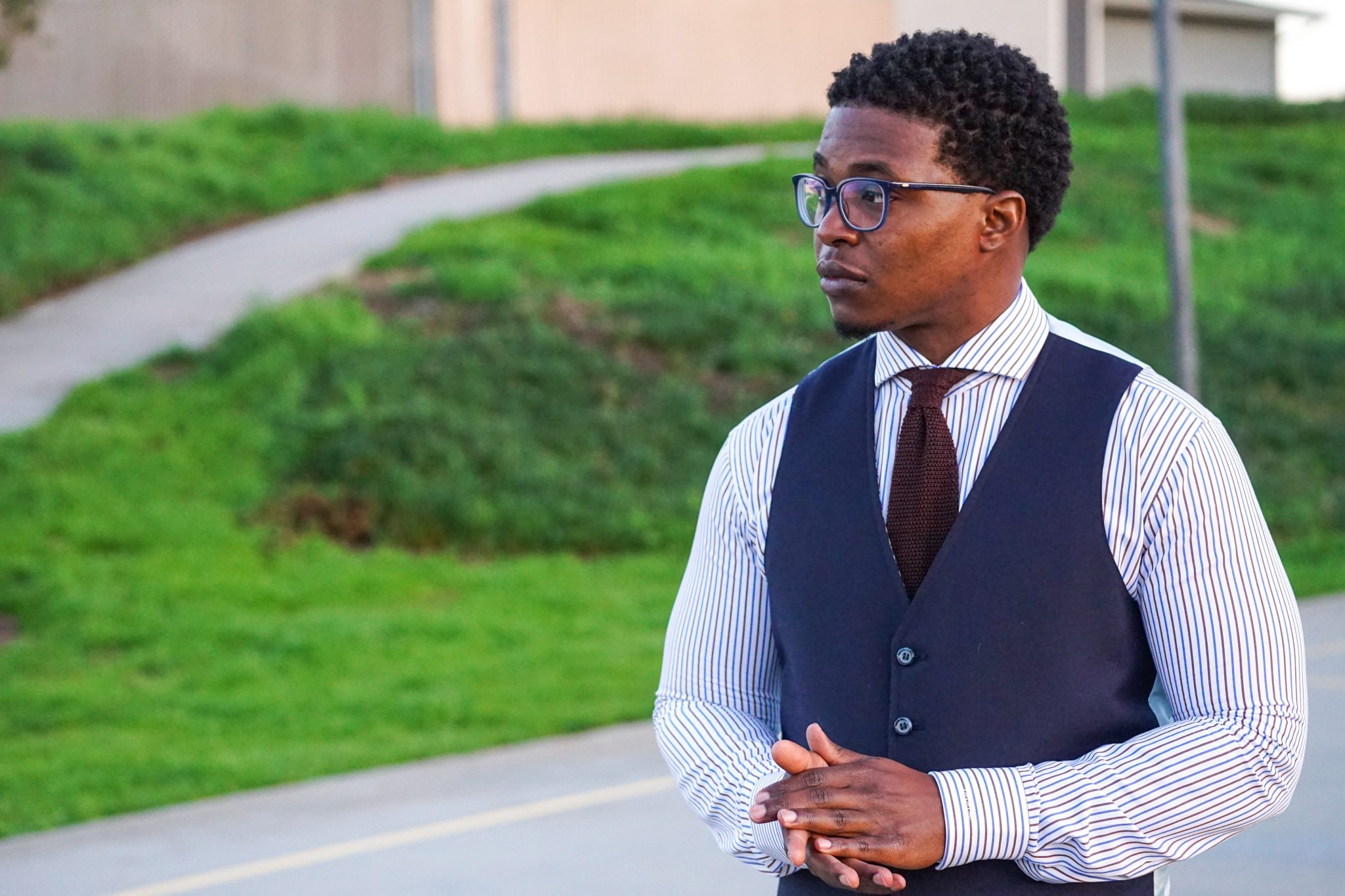 dapper-advisor-invest in yourself-black-man-wearing-navy-waistcoat-brown-silk-knit-tie-custom-itailor-stripe-shirt-men-4
