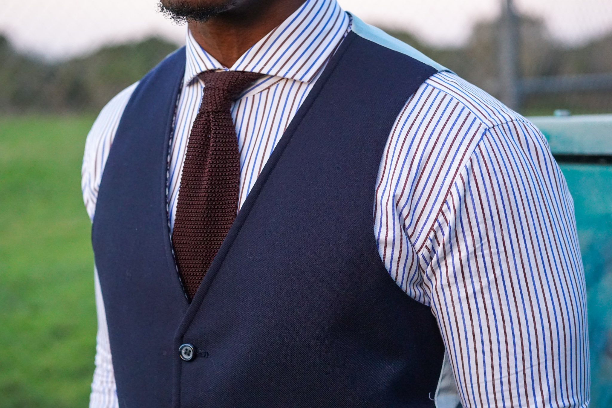 dapper-advisor-black-man-wearing-navy-waistcoat-brown-silk-knit-tie-custom-itailor-stripe-shirt-men-1