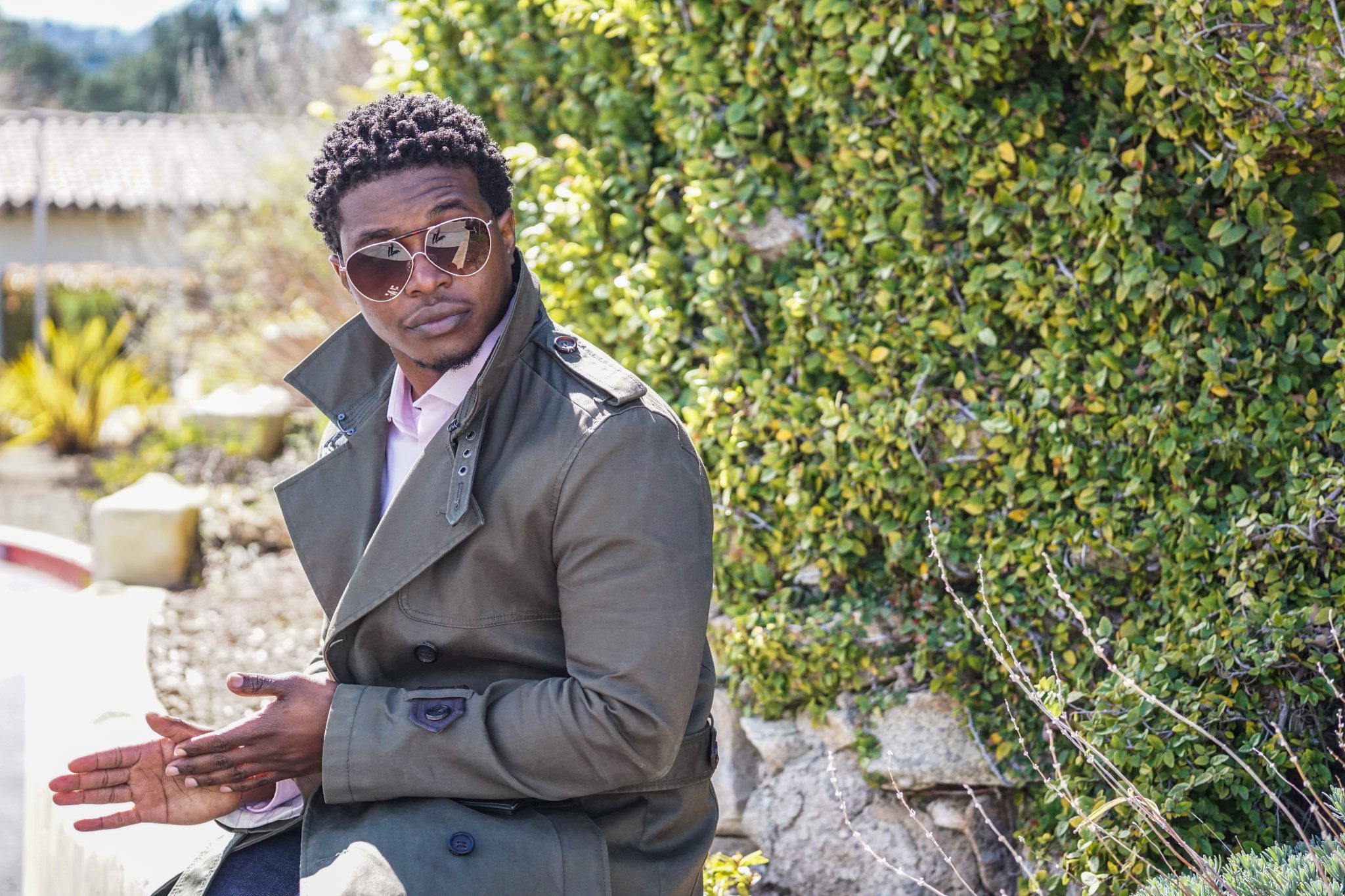 dapper-advisor-black-man-wearing-olive-trench coat-pink-shirt-aviator-glasses-2