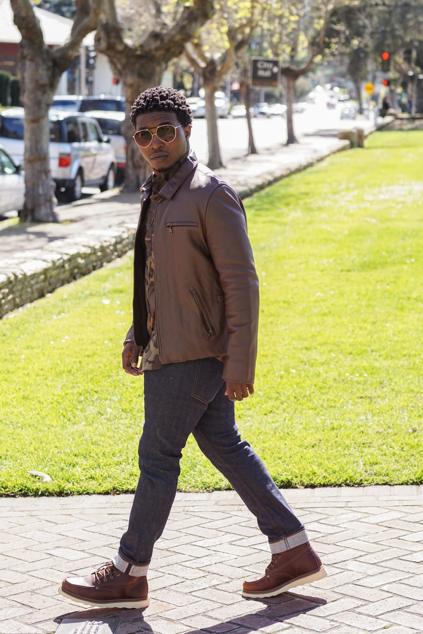 dapper-advisor-black-man-wearing-earth tones-brown-leather-jacket-camo-shirt-raw-denim-jeans-moc-toe-boots-2