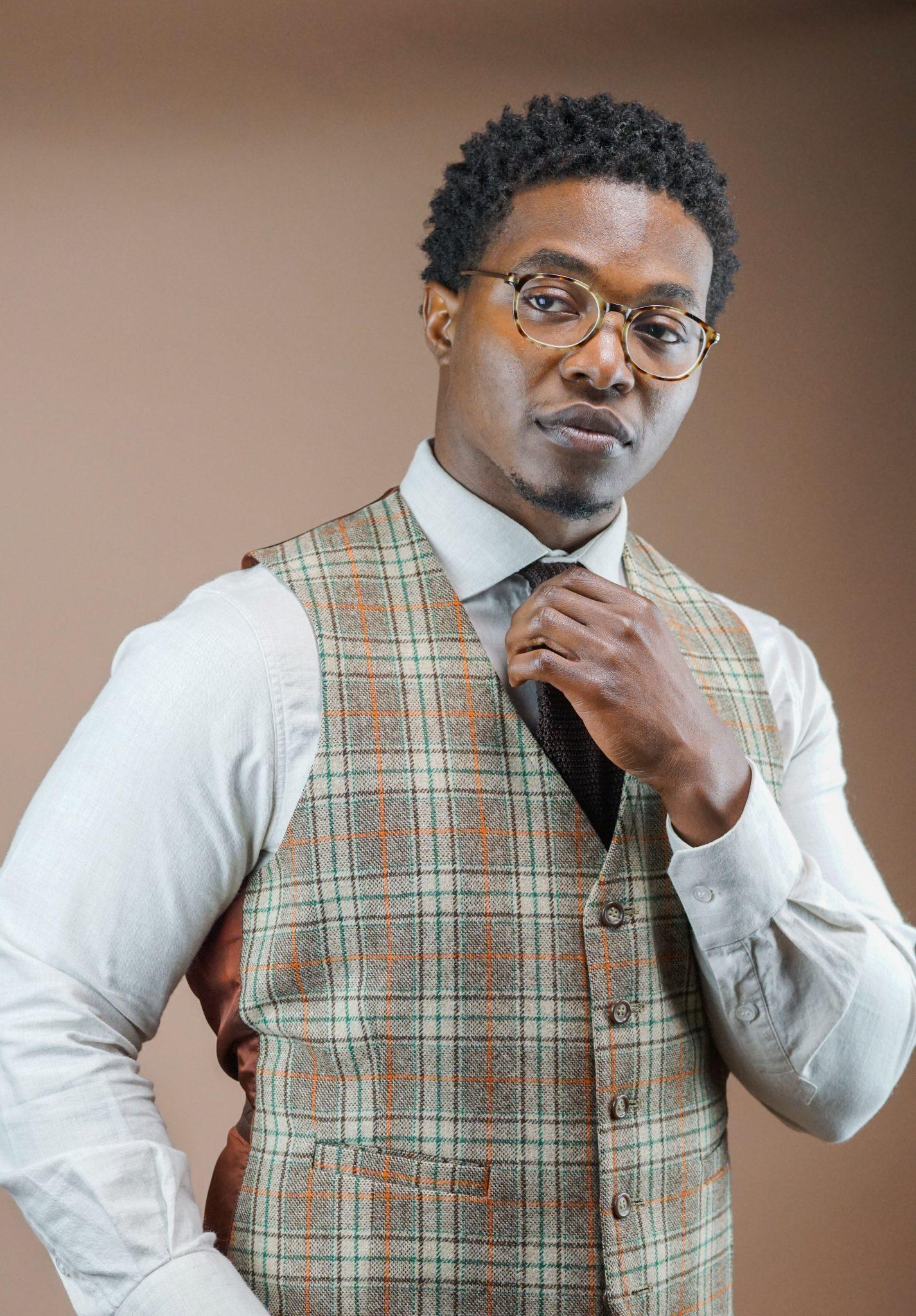 dapper-advisor-casually tailored-plaid-waistcoat-raw-denim-jeans-silk-knit-tie