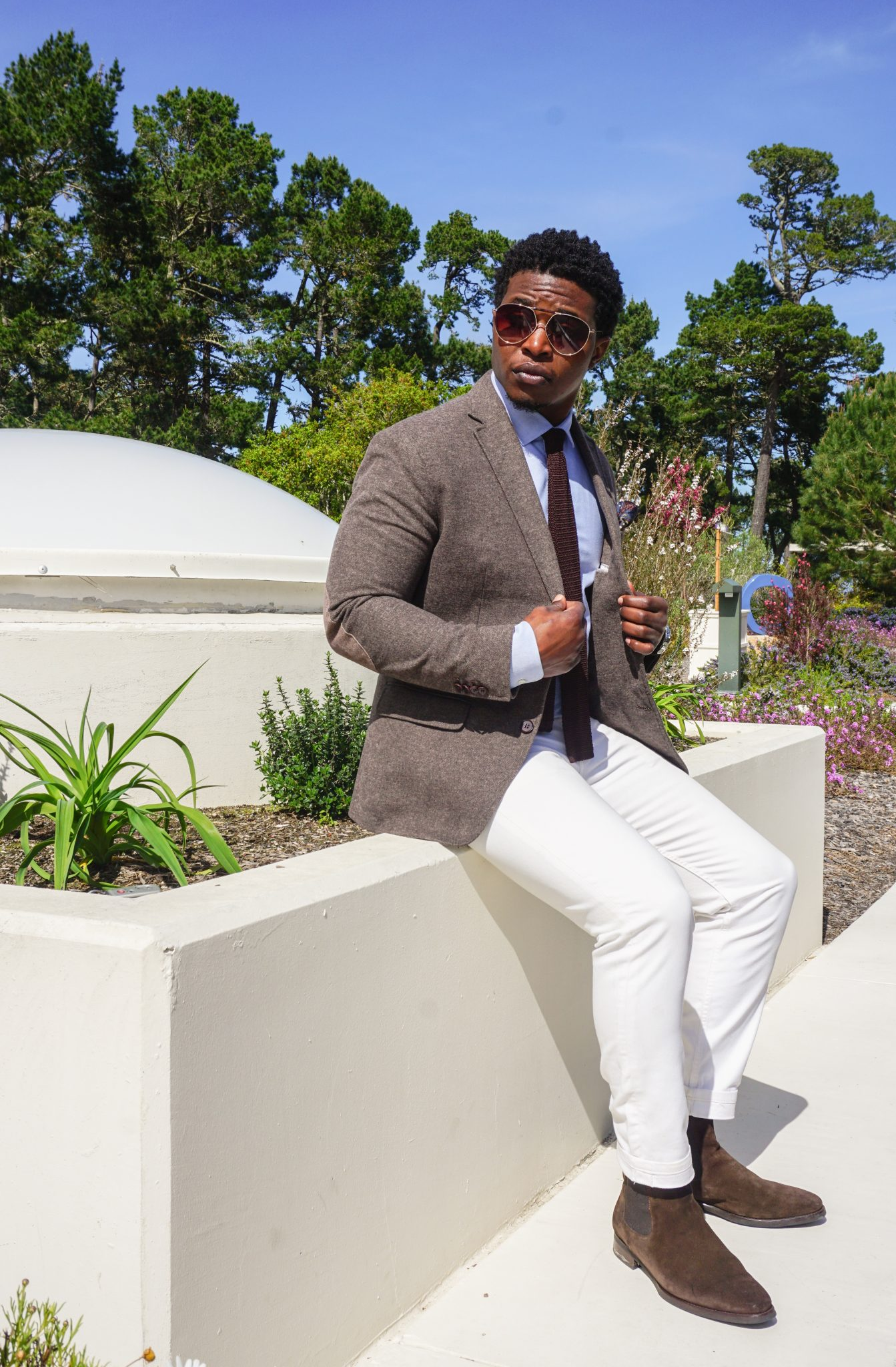 dapper-advisor-casually tailored-black-man-wearing-white denim jeans-brown-blazer-brown-suede-chelsea-boots-1
