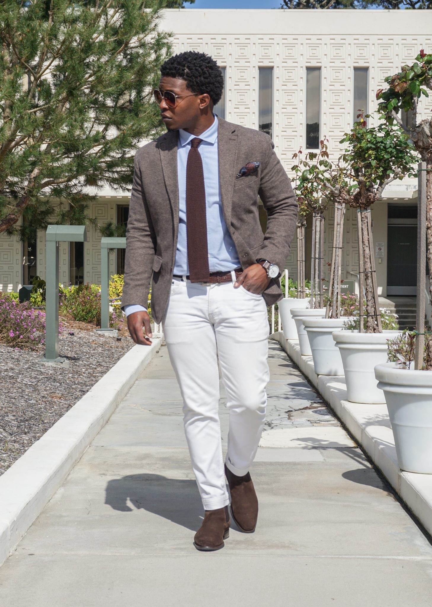 dapper-advisor-casually tailored-black-man-wearing-white denim jeans-brown-blazer-brown-suede-chelsea-boots-2