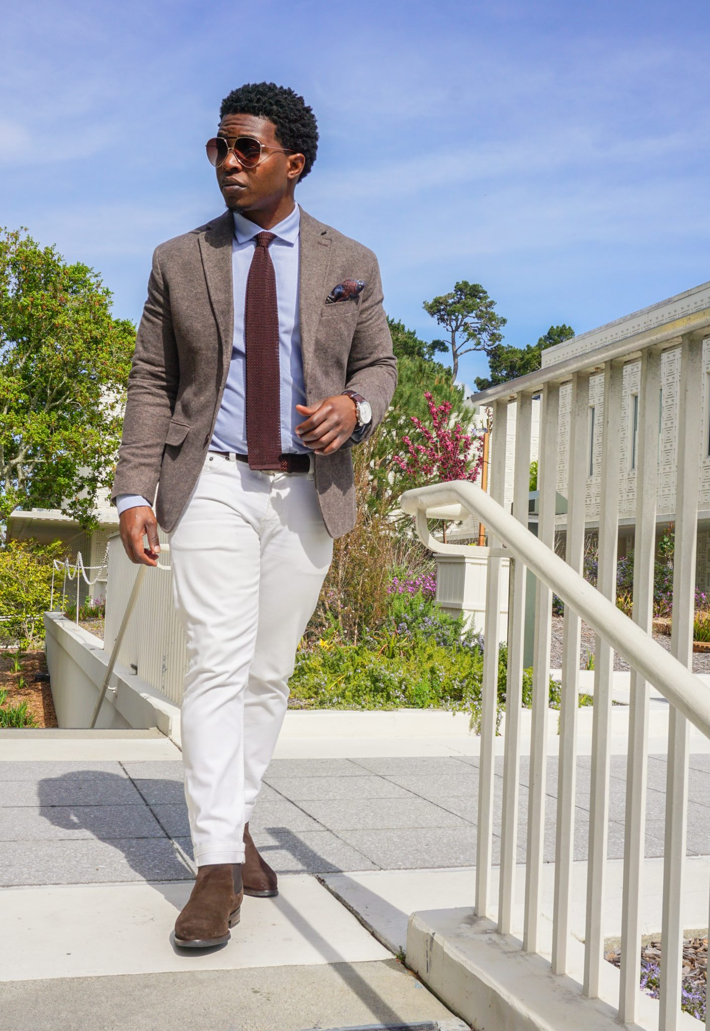 dapper-advisor-casually tailored-black-man-wearing-white denim jeans-brown-blazer-brown-suede-chelsea-boots-5