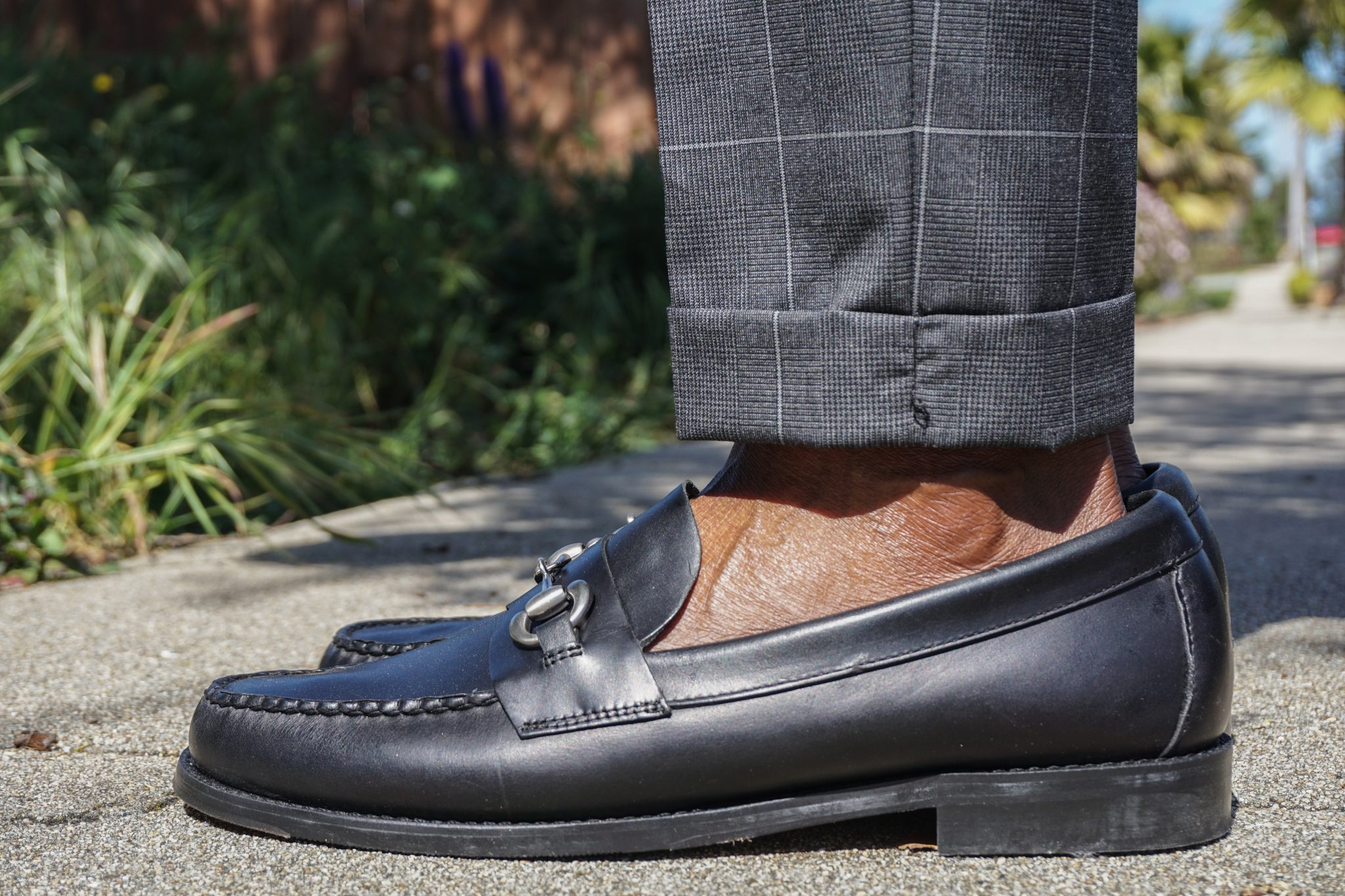 dapper-advisor-black-horsebit loafers-no show socks-grey windowpane-trousers