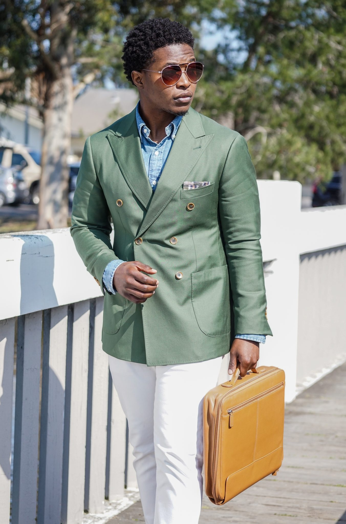 dapper-advisor-black-man-wearing-green-blazer-white-denim-jeans-brown-leather-briefcase-style tips-2