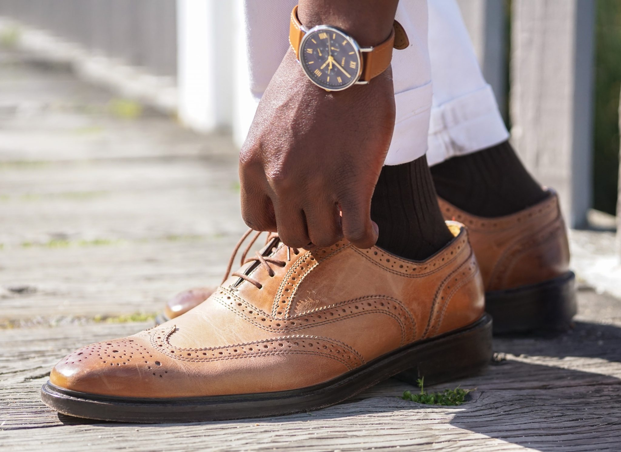 dapper-advisor-black-man-wearing-brown-leather-wingtips-shoes-timex-southview-multifunction-watch