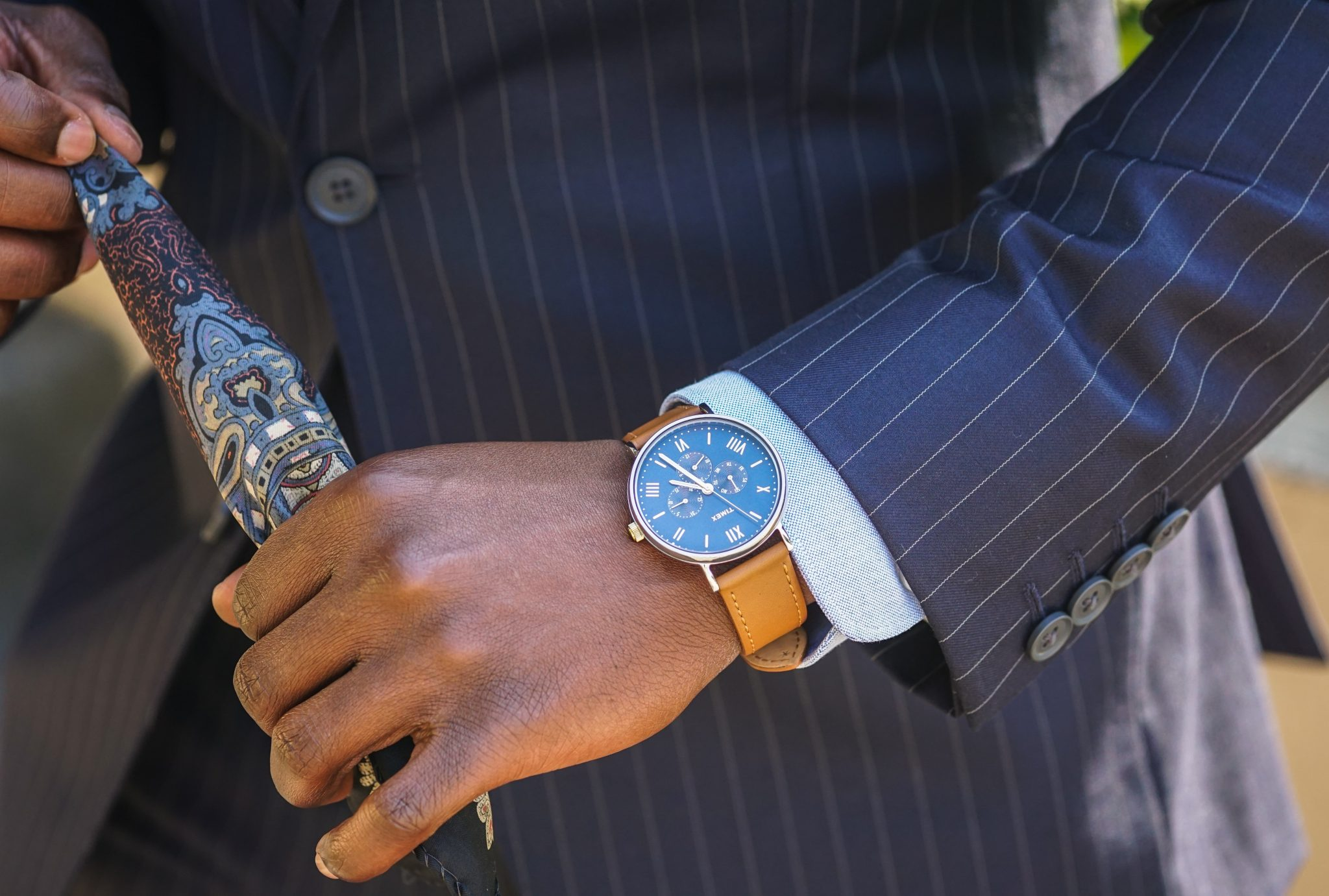 dapper-advisor-dress like a boss-black-man-wearing-navy-pinstripe-suit-business-attire-timex-multifunction-watch
