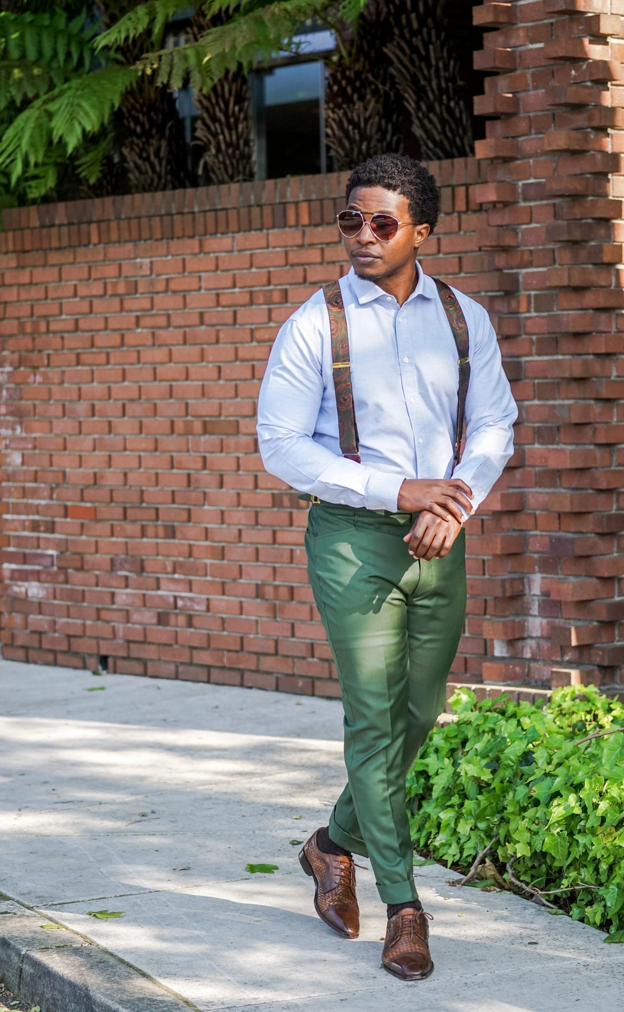dapper-advisor-black-man-wearing-green-custom-made-trousers-blue-oxford-shirt-green-suspenders-vintage accessories-2