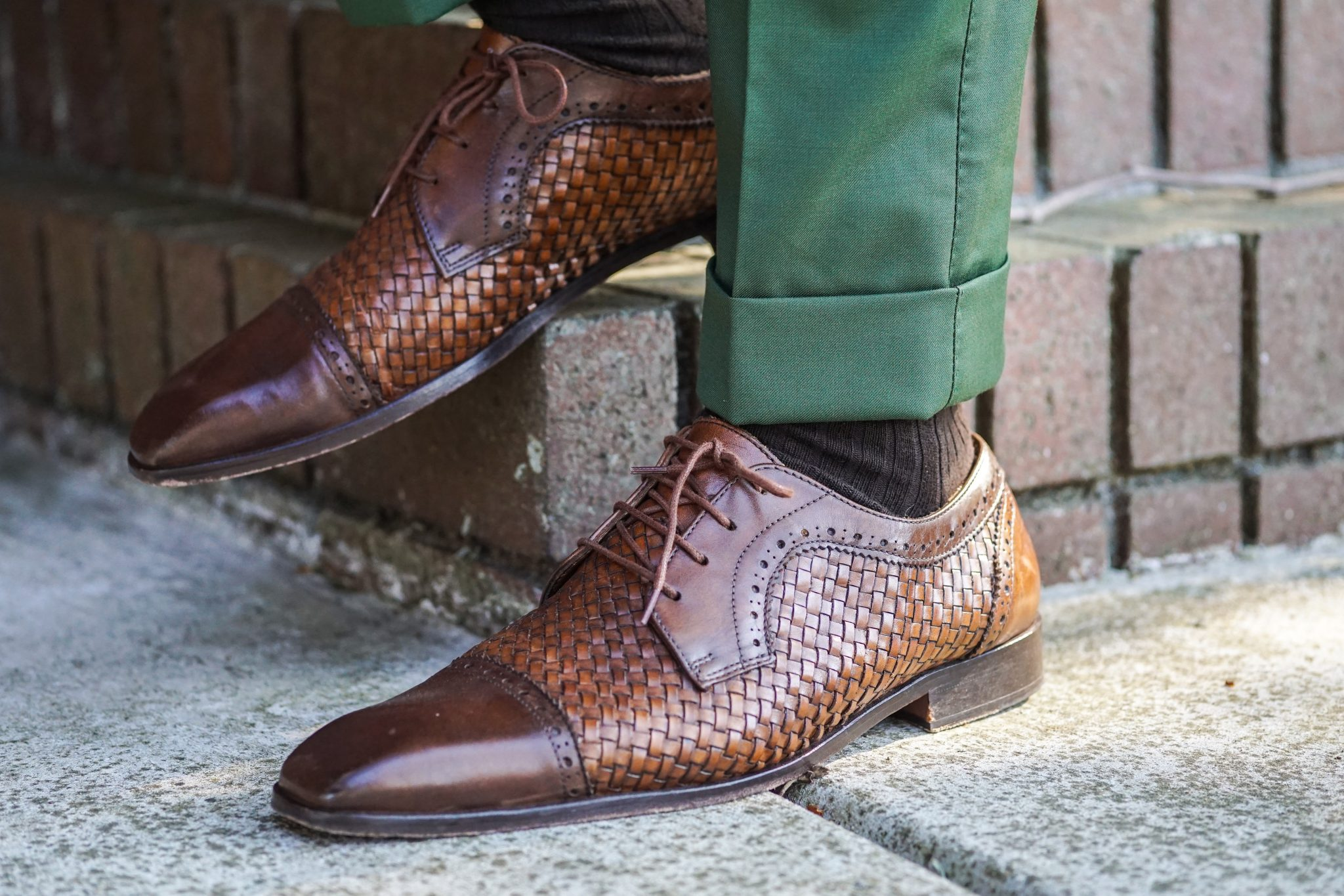 green trousers-brown leather woven captoe shoes