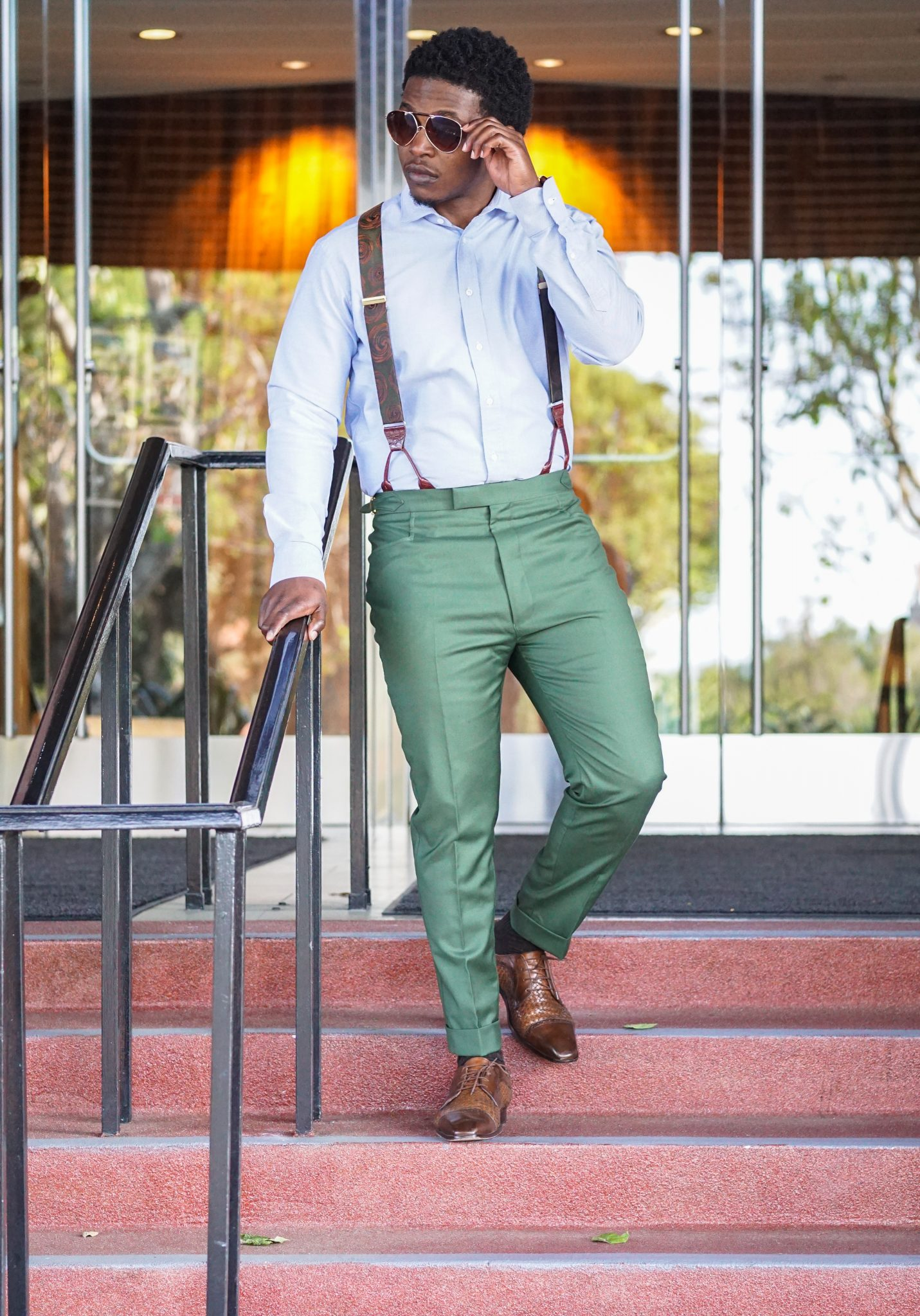 dapper-advisor-black-man-wearing-green-custom-made-trousers-blue-oxford-shirt-green-suspenders-vintage accessories-3
