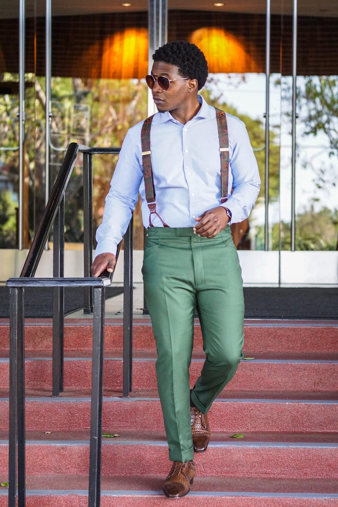 dapper-advisor-black-man-wearing-green-custom-made-trousers-blue-oxford-shirt-green-suspenders-vintage accessories-1