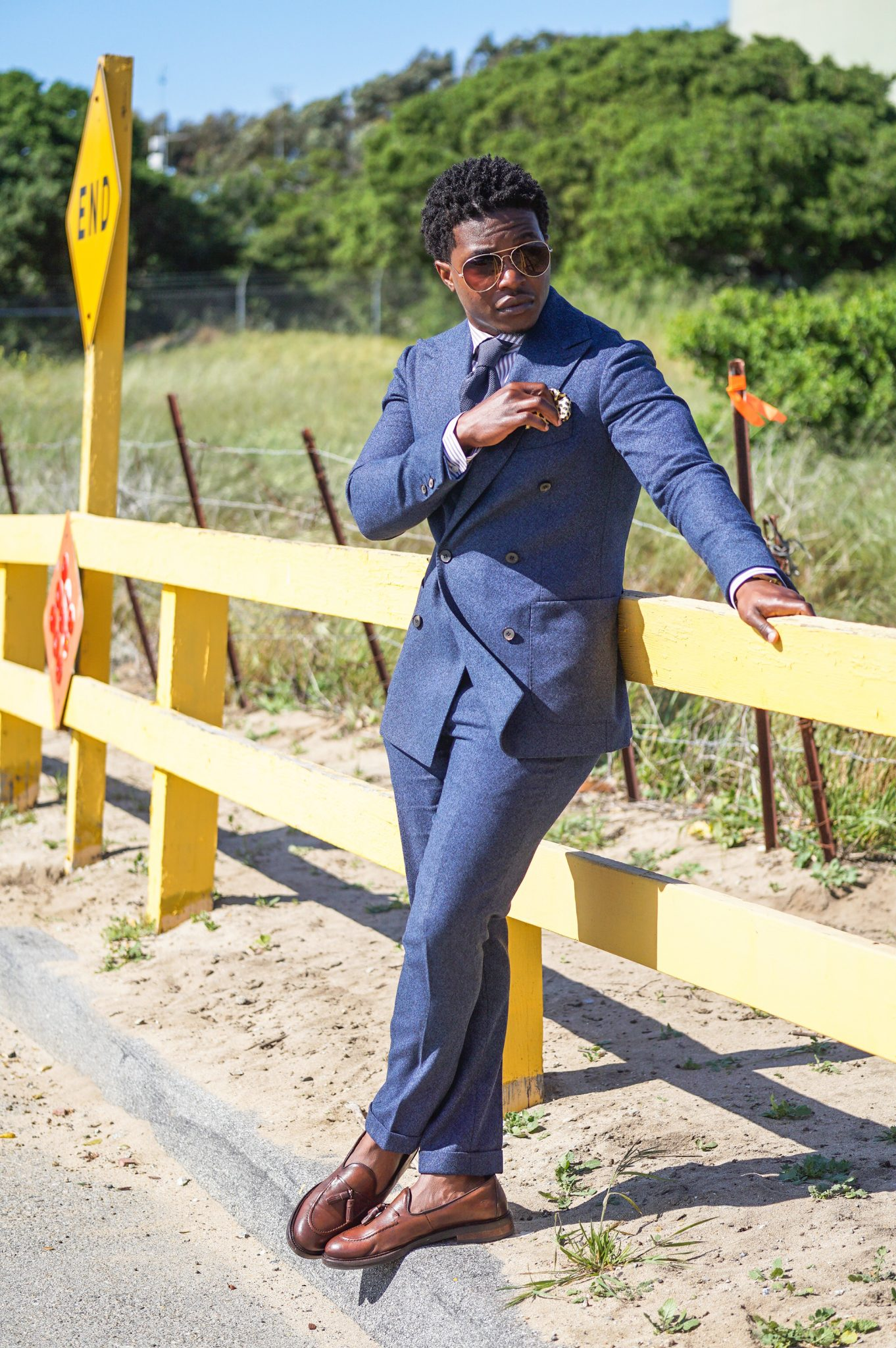 dapper advisor-black man-blue-suit supply madison fit-pop of color-brown tassel loafers-yellow pocket square-3