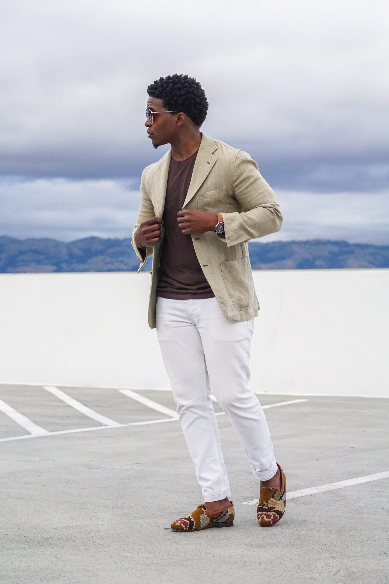 dapper advisor-wearing-linen blazer-white denim jeans-res ipsa-loafers-3