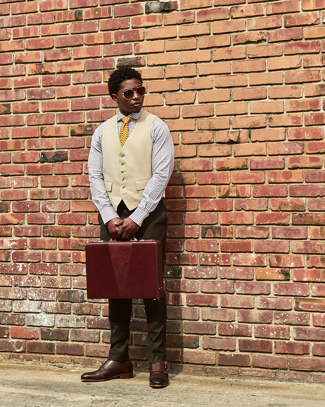 dapper advisor-black man-wearing-linen waistcoat-yellow-hermes-tie-brown-stripe-suitsupply-dress shirt-vintage-hard case-briefcase-oliver wicks-double monkstraps
