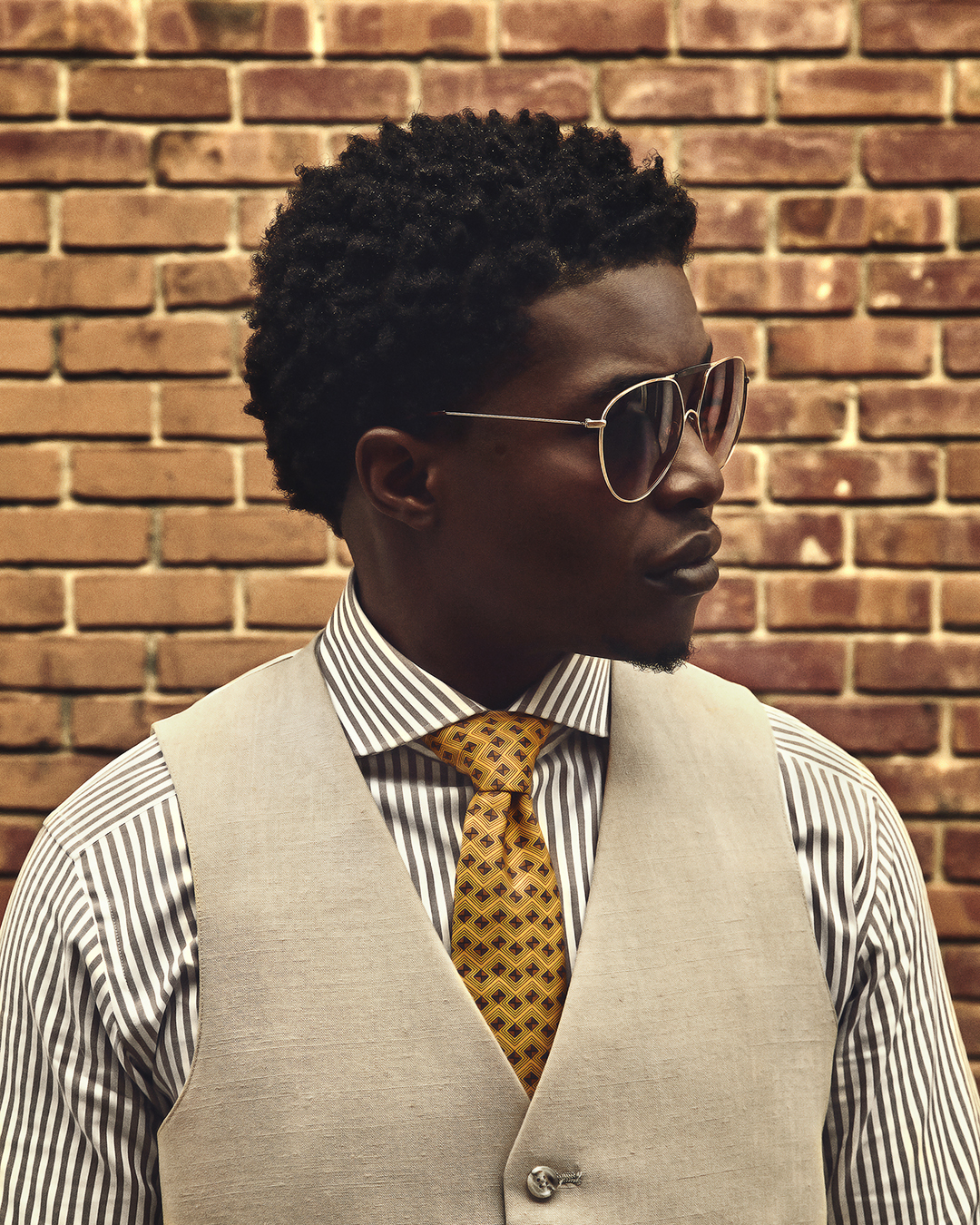 dapper advisor-black man-wearing-linen waistcoat-yellow-hermes-tie-brown-stripe-suitsupply-shirt