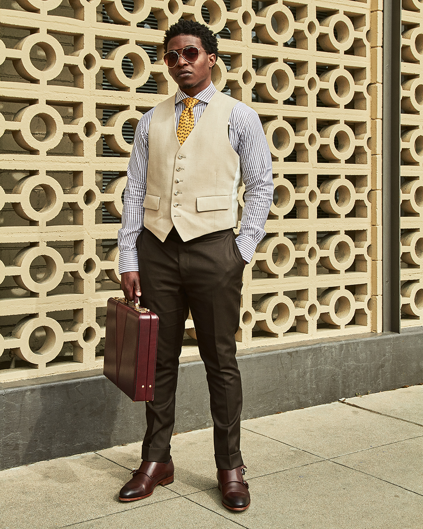 dapper advisor-black man-wearing-linen waistcoat-yellow-hermes-tie-brown-stripe-suitsupply-dress shirt-vintage-hard case-briefcase-oliver wicks-double monkstraps-2