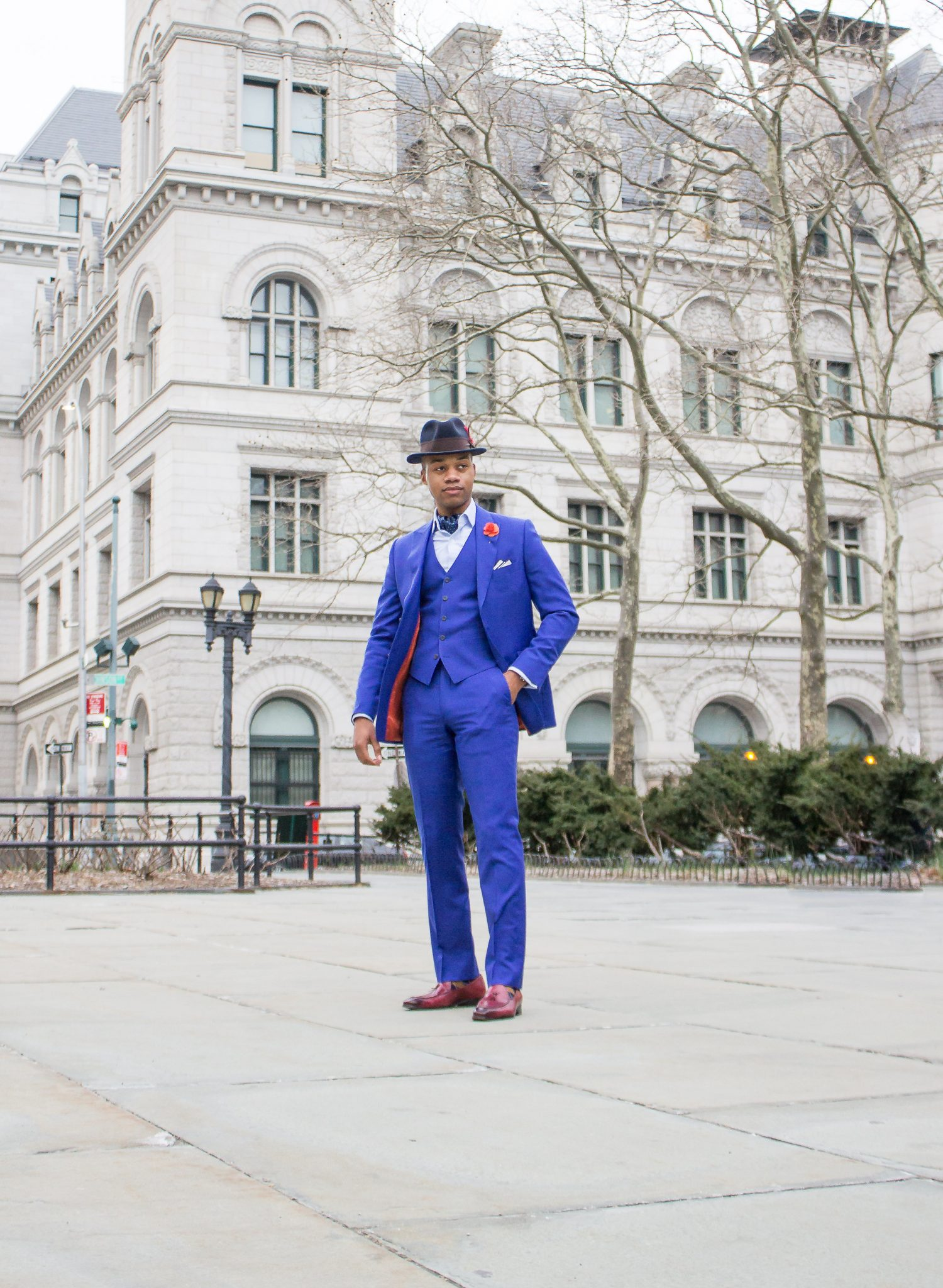 Tyron Cutner-royal blue three piece suit-brown wool fedora-oxblood tassel loafers