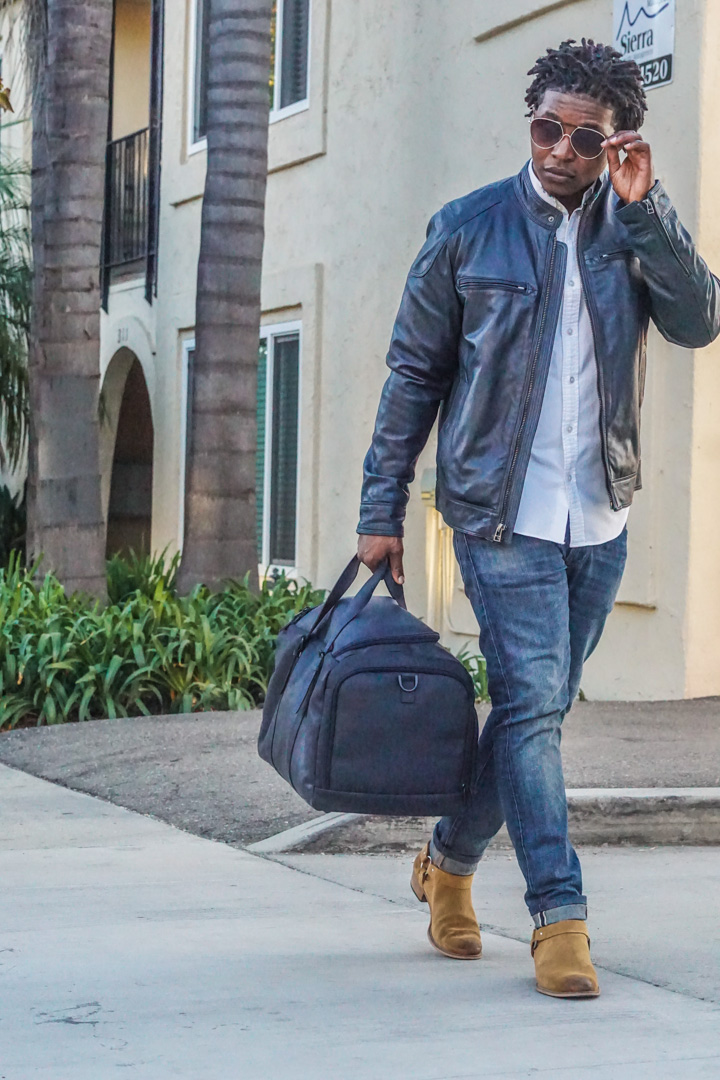 dapper advisor-wilsons leather navy blue leather moto jacket-white oxford shirt-WILSONS LEATHER Navy Blue VACQUETA LEATHER DUFFEL Bag-4