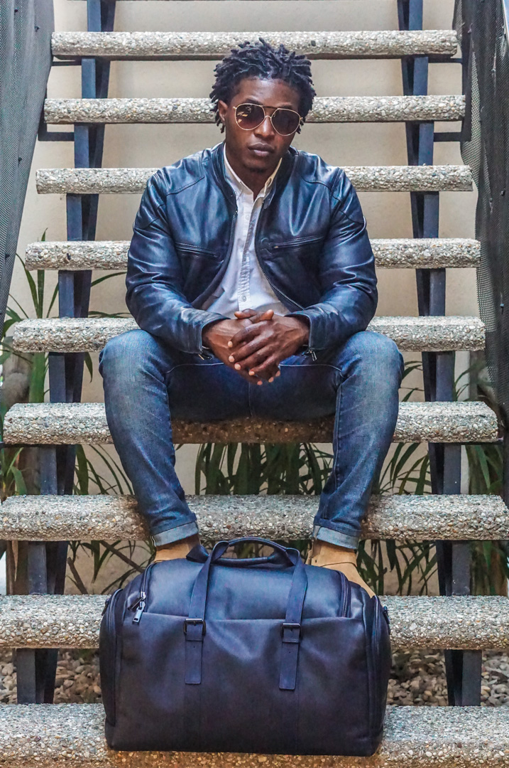 dapper advisor-wilsons leather navy blue leather moto jacket-white oxford shirt-WILSONS LEATHER Navy Blue VACQUETA LEATHER DUFFEL Bag-1